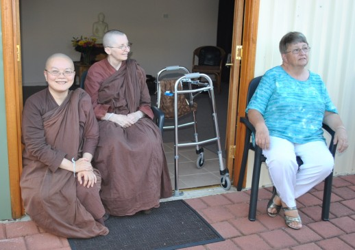 Ayya Vayama Bhikkhuni, Ayya Seri Bhikkhuni and Jacky waiting for the action to begin outside the Sala of Patacara Bhikkhuni Hermitage on 28th of April 2013.