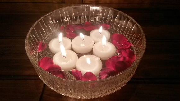 The lights of the floating candles signifying our wish for peace, lovingkindness and understanding to all beings.