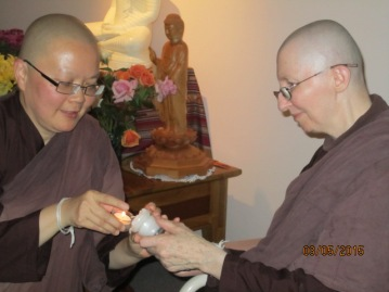 Ayya Vayama Bhikkhuni was lighting the candle to be offered to the Shrine for Vesak Day 3rd of May 2015