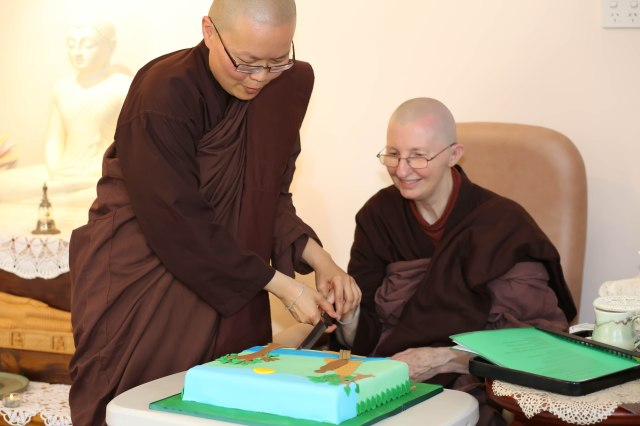 Ayya Vayama Bhikkhuni and Ayya Seri Bhikkhuni were cutting the cake offered to mark the 5th Rains Retreat and Ceremony at Patacara Bhikkhuni Hermitage on 31st of October 2015. Photo by Zor