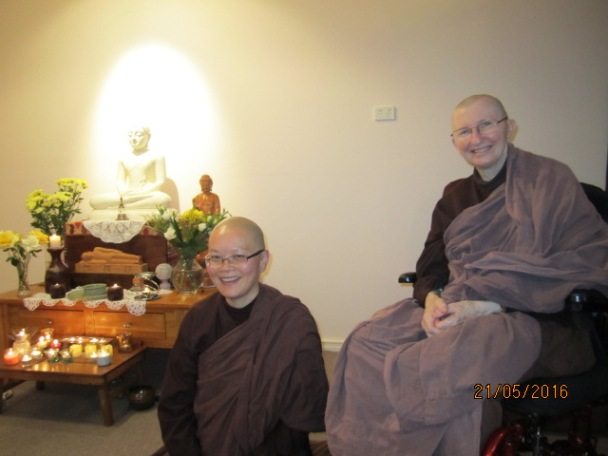 Ayya Vayama Bhikkhuni and Ayya Seri Bhikkhuni with the lights and candles inside the Sala of Patacara Bhikkhuni Hermitage on Vesak Meditation Day 2016. Photo by Ming.
