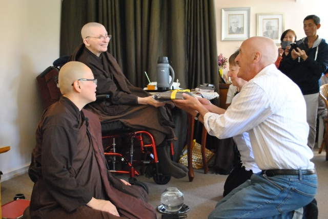 Meery and Trevor Taylor offered the End of Rains Cloth to the Bhikkhunis of Patacara Bhikkhuni Hermitage on 30tj October 2016. Photo by Havindra.