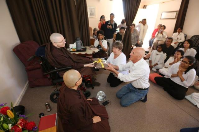 Merry and Trevor Taylor offered the End of Rains Cloth to the Bhikkhunis at Patacata Bhikkhuni hermitage 2016. Photo by Zor